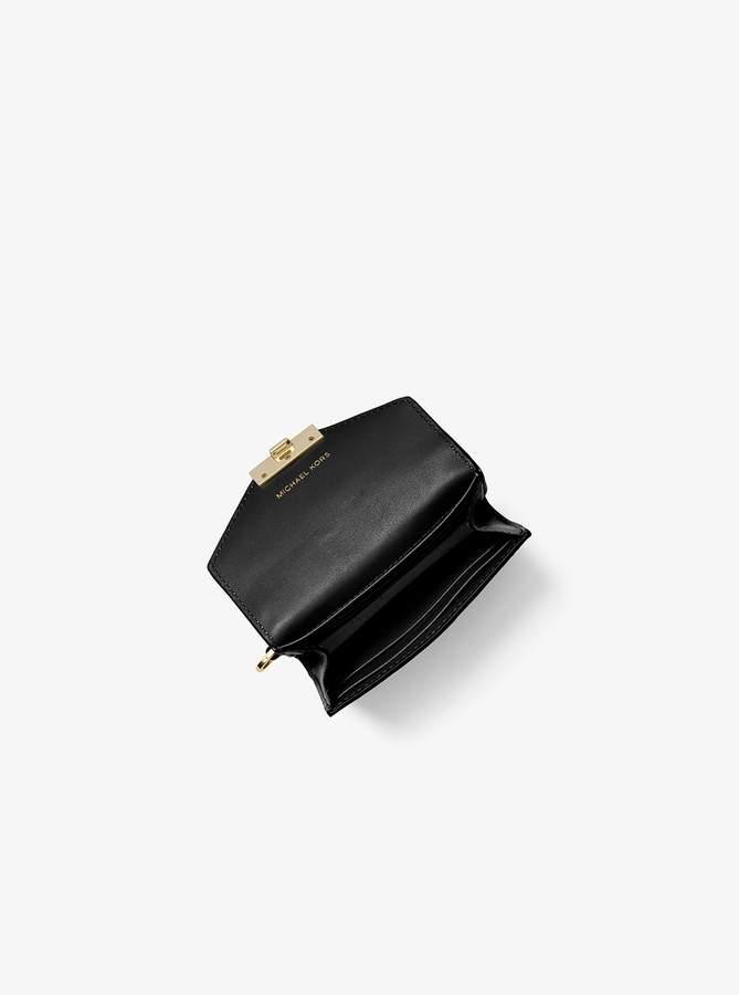 bbb3eb22a834fb Michael Kors Black Chain Handbag - ShopStyle