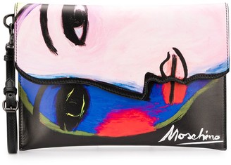 Moschino painted face clutch bag