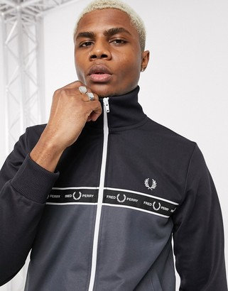 Fred Perry chest taped cut and sew track jacket in black and grey