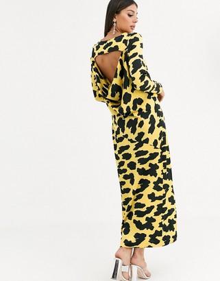 Asos DESIGN cowl back maxi dress in yellow cow animal print