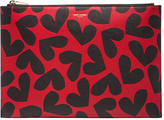 kate beckinsale  Who made  Kate Beckinsales red heart print clutch handbag?