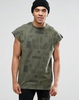 Asos Oversized Sleeveless T-Shirt With Military Print In Khaki