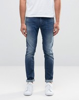 Sisley Super Skinny Distressed Jeans in Mid Wash Blue