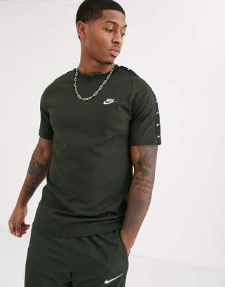 Nike Swoosh t-shirt with taping detail in khaki-Green