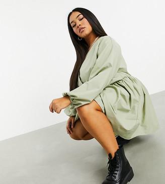 ASOS DESIGN Curve casual cotton poplin wrap front mini smock dress in light khaki