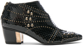 Rodarte for FWRD Embossed Studded Leather Booties in Animal Print,Black.