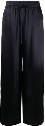 Co High-Rise Flared Trousers