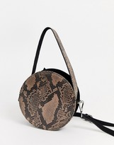 Asos Design DESIGN suede circle cross body bag in snake print
