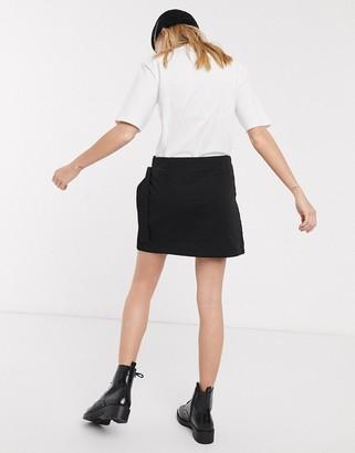 Weekday wrap clip-belt mini skirt in black