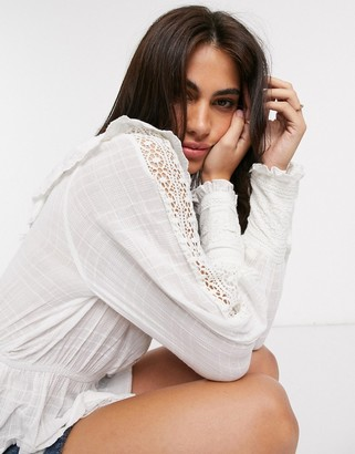 Y.A.S blouse with crochet and ruffle detail in white
