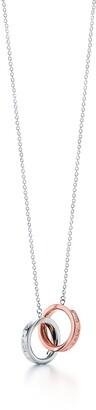 Tiffany & Co. 1837TM interlocking pendant in sterling silver and Rubedo metal
