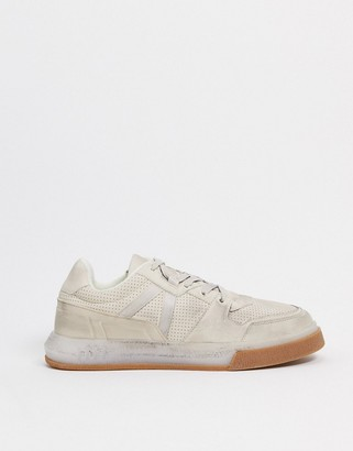 ASOS DESIGN distressed sneakers with gum sole