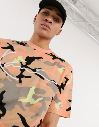 Karl Kani Signature Camo tee in camel/pink