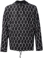 Undercover geometric print hooded jacket - men - Polyester - 2