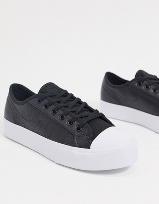Lacoste ziane leather lace up sneakers in black