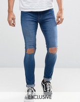 Reclaimed Vintage Washed Super Skinny Jeans With Knee Rips
