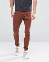 Asos Super Skinny Jeans In Rust