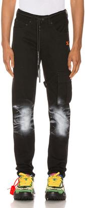 Off-White Slim Asymmetric Jeans in Black | FWRD