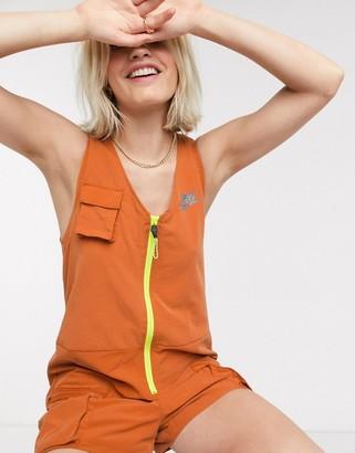Nike utility playsuit in rust orange