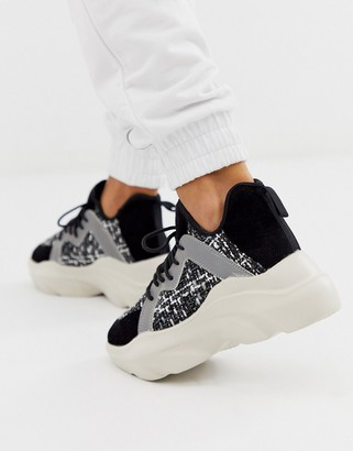 ASOS DESIGN Director chunky lace up sneakers in black/white/reflective