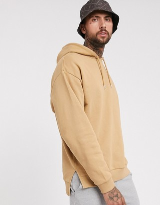 ASOS DESIGN oversized hoodie with split and dropped hem in tan