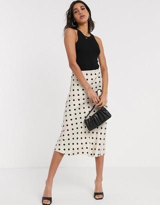 B.young polka dot bias cut skirt
