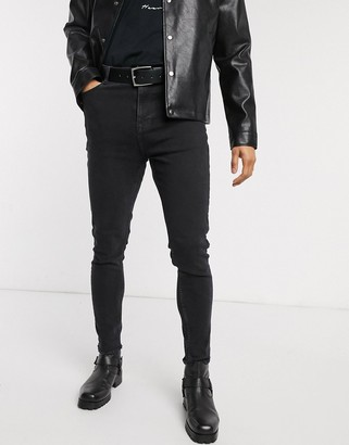 Asos Design DESIGN high waisted skinny jeans with raw hem in washed black