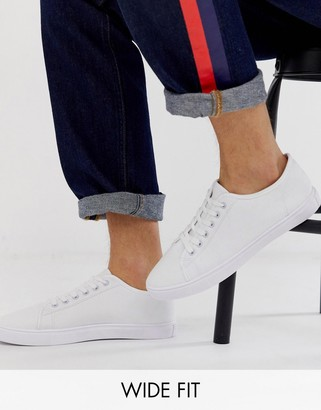 ASOS DESIGN Wide Fit trainers in white canvas