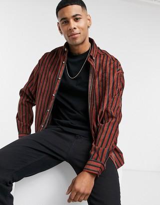 ASOS DESIGN 90s oversized shirt in rust cord narrow stripe