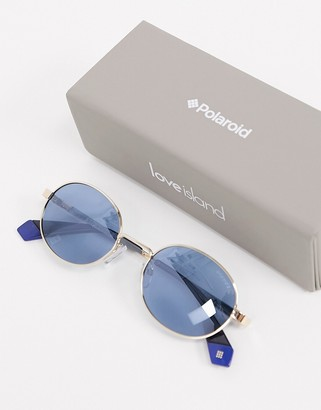 Polaroid X Love Island round sunglasses in gold with blue lens