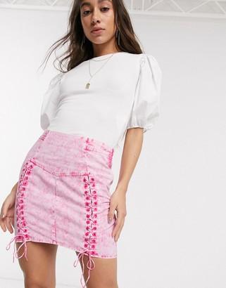 Asos DESIGN corset detail mini skirt in washed pink
