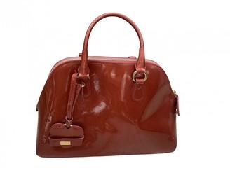 Moschino Burgundy Patent leather Handbags