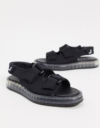 Joshua Sanders sandal with transparent sole in black