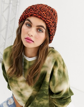 ASOS DESIGN two tone knit beanie hat in orange and black