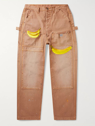 KAPITAL Appliqued Distressed Cotton-Canvas Trousers