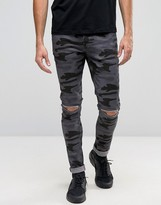 Asos Super Skinny Jeans With Knee Rips In Black Camo
