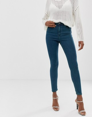 Asos Design DESIGN Ridley high waisted skinny jeans in mid wash with green tint-Blue