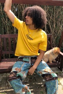 GUESS Originals UO Exclusive LA Logo Solar Power T-Shirt - Yellow S at Urban Outfitters