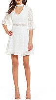 Lucy Paris Bell Sleeve Embroidered Mockneck Dress