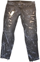 Balmain Distressed Jeans With Metal Ins.