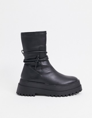 Public Desire Finale chunky flat ankle boots with tie in black