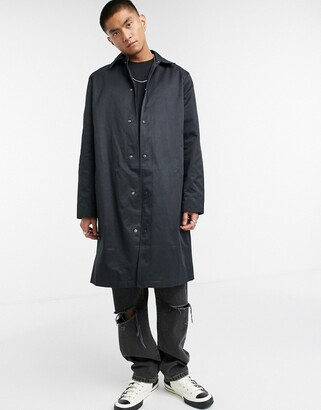 ASOS DESIGN oversized trench coat in black with poppers