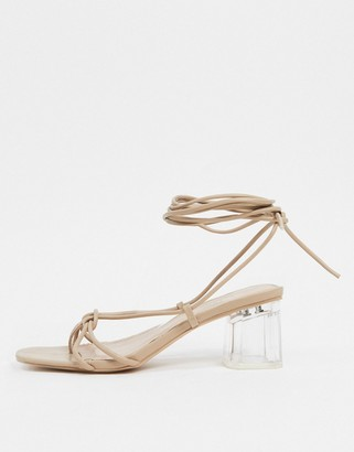 BEBO tie leg mid heeled clear sandals in beige