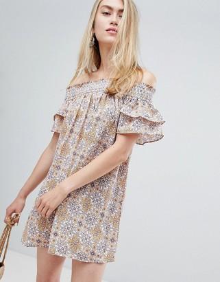 En Creme off shoulder floral mini dress