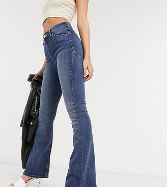 ASOS DESIGN Petite hourglass 'lift and contour' flare jeans in midwash