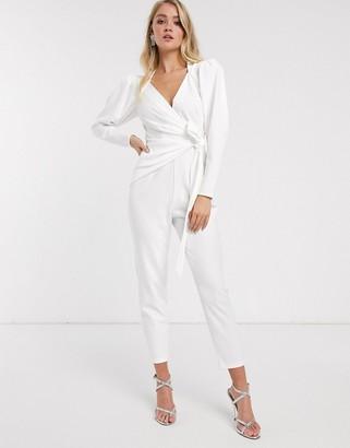 Asos Design DESIGN wrap front jumpsuit with shoulder pad detail