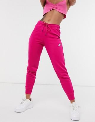 Nike essential tight fit fleece track pants in dark pink