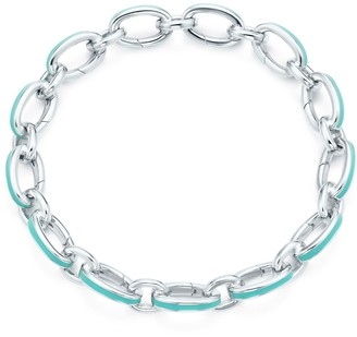 "Tiffany & Co. Blue clasping link bracelet in silver with enamel finish, 8"" long"