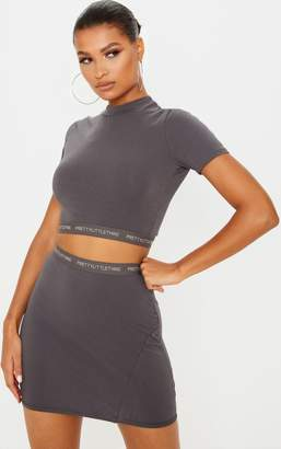 PrettyLittleThing Lead Grey Tape Jersey Crop T Shirt