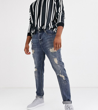 ASOS DESIGN Tall tapered jeans in dark wash blue with heavy rips